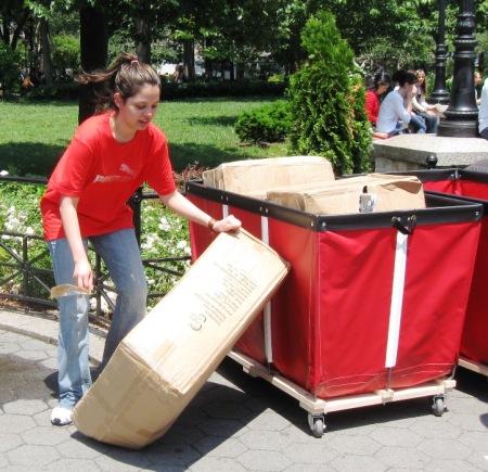 A Puma representative unpacks the Soles4Souls Flip Flops