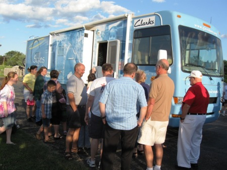 Church members line up to visit inside of RV.