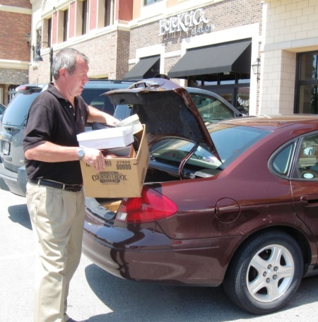 Several times, Allan went out to customer's cars to help carry in boxes of shoes.