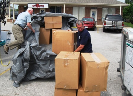 Allan helping unload 400 pairs of shoes