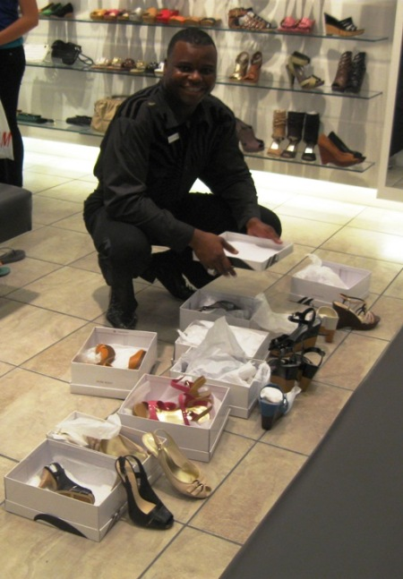 Nine West employee still smiling after customer tries on 10 pairs of shoes and leaves without buying anything.