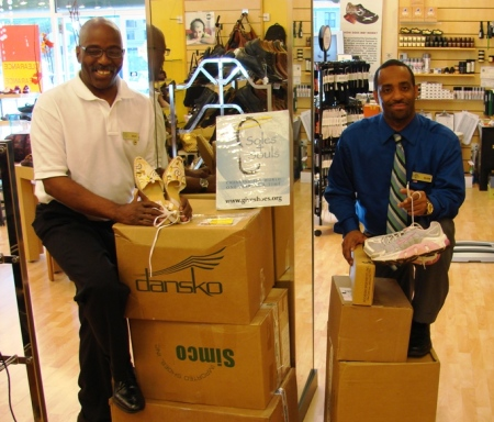 Dean and Alvin with boxes of donated shoes ready to be shipped to the warehouse