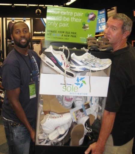 Rob and Allan moving container of donated shoes