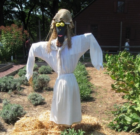 Sammy adding some personality to a faceless scarecrow at Morristown National Historic Park