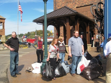 Rocky employees bringing bags of shoes